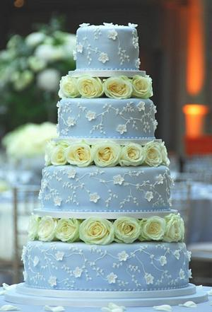Blue Wedding Cake With White Roeses