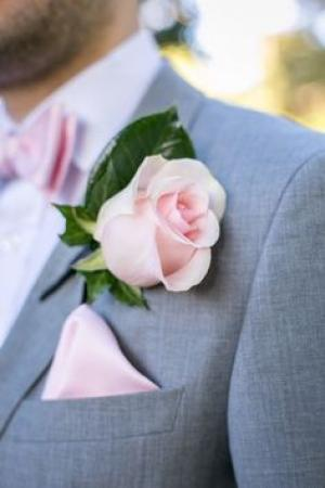 blush_touches_groom_suit.jpg