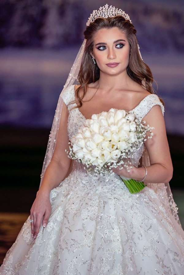 Mariam with her white peony wedding bouquet