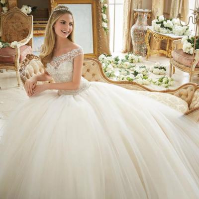 Mme Alandaloussi Pour les Robes de Mariées