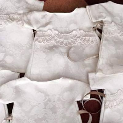 Woman Re-Purposes Wedding Dress Into Gowns For Stillborn Babies