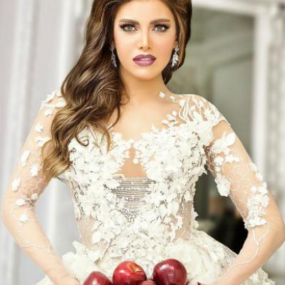 أجمل فساتين الزفاف التي تألقت بها النجمات العربيات