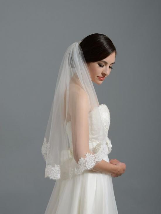 طرحة العروس التي يصل طولها إلى المرفق