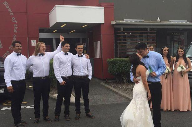 Bride and Groom Take Wedding Pictures Outside KFC