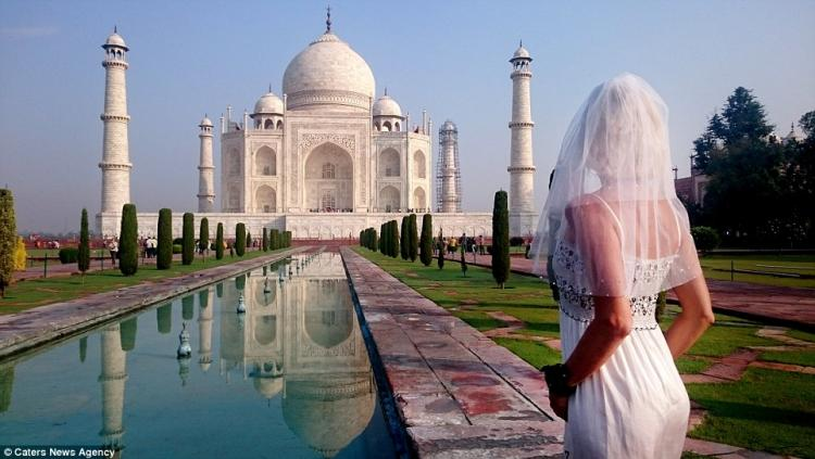 Woman Travels The World in Her Wedding Dress After Divorce