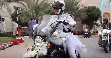 Emirati Couple Goes to their Wedding on a Motorcycle