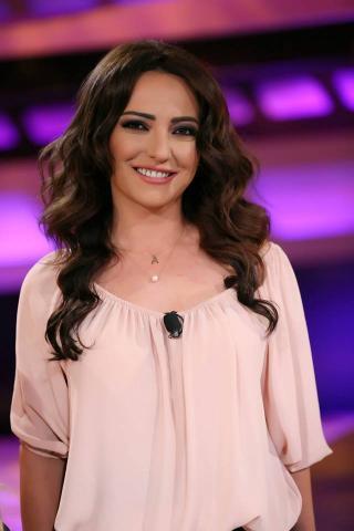 Amal Arafa Wears a Wedding Dress Again