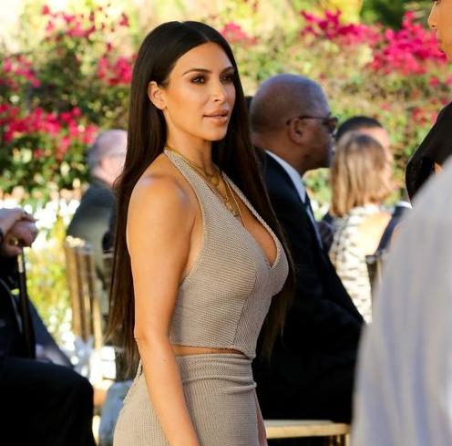 Kim Kardashian and Kanye West Attend Wedding