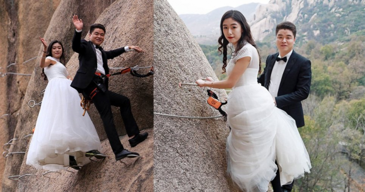 Chinese Couple Climbs Dangerous Mountain To Have Their Wedding Photos