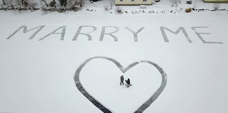 A Marriage Proposal Message Carved on Frozen Lake