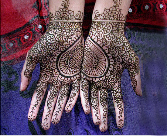 Mehndi Hand Name : An indian wedding henna with her husbands name on palm
