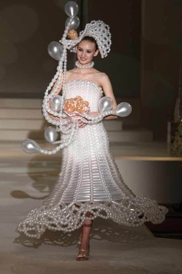 Strange wedding dresses arabia weddings for Most unique wedding dress designers