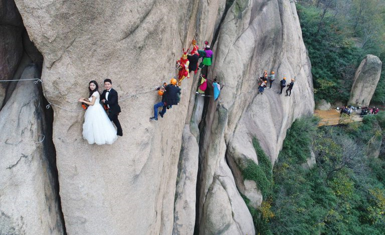 Chinese Couple Climbs Dangerous Mountain To Have Their ... Cliffs Of Moher